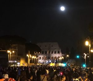 full oon over the Colosseum, bicycling Rome